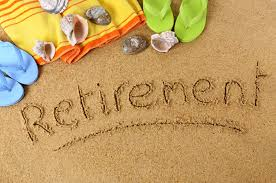 "Word ""retirement"" written in sand"