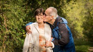 Retirees kissing