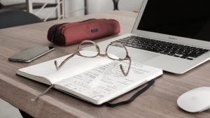 glasses, notebook and laptop - necessary requisites for studying