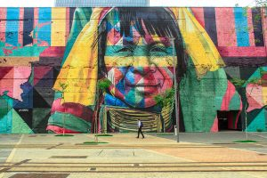 Colorful mural of a native face