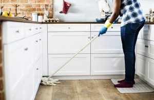 a person cleaning the kitchen