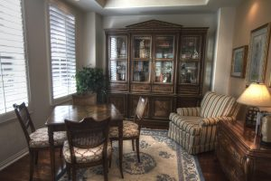 A living room with a china cabinet in it