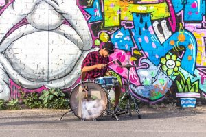 Drummer playing drums on the street