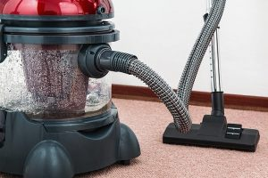 A vacuum cleaner on a carpet.
