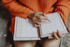 a girl holding an agenda