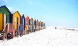 A row of beach huts painted in bright colors.