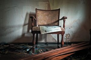 an old chair as an example of what to throw away before moving