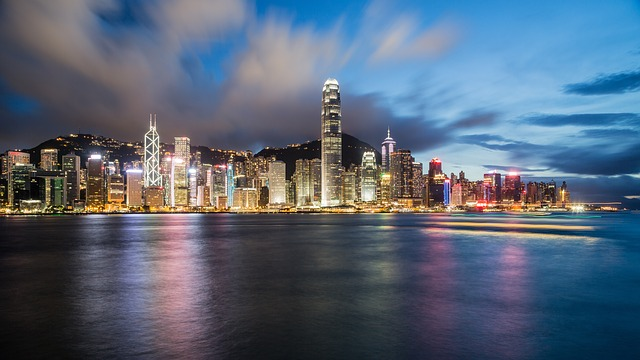 The Hong Kong panorama at night, representing Americans moving to Hong Kong.