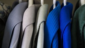 A close-up view of clothes in a closet.