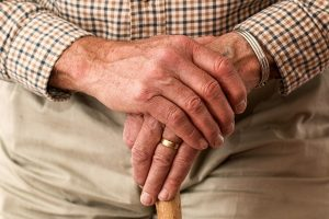 Hands holding a cane