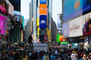 Times Square full of people, and you will enjoy it immensely after moving to the Big Apple after college.