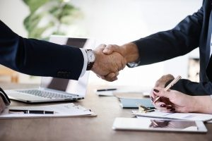 Shaking hands after signing a contract on leasing a commercial property in Florida