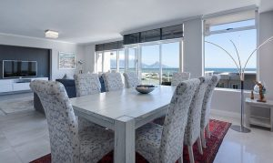 A dining room, which is one of the rooms you need to pay attention to when selling your Miami property