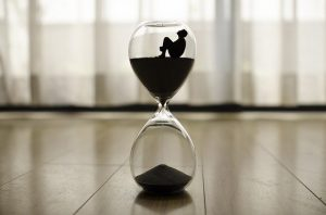 A man trapped in an hourglass.