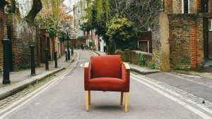 AN armchair on the street.