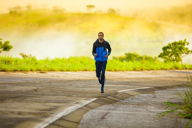 A man running along a road, in order to become fit in no time after moving out of Miami.