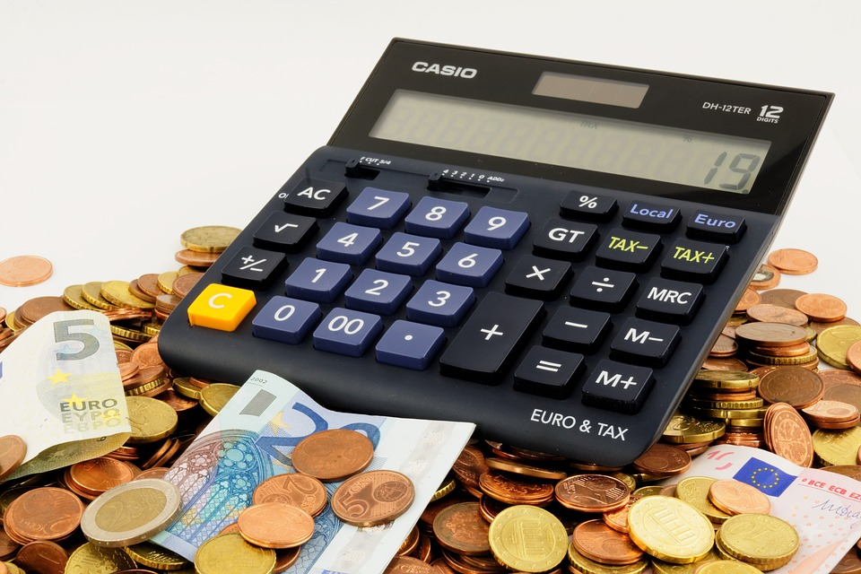 a calculator, coins and banknotes because it is vital to calculate your moving costs