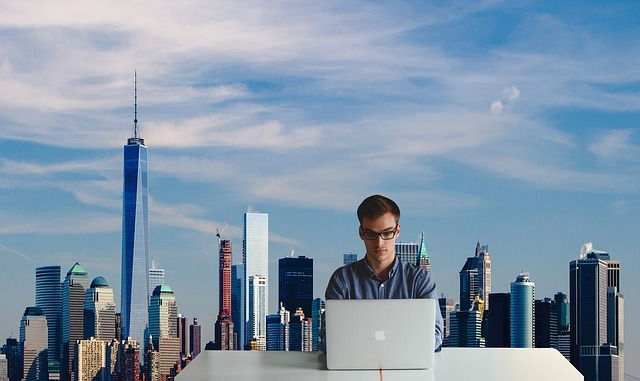A boy using a laptop to find out all about the best NYC areas for young professionals.