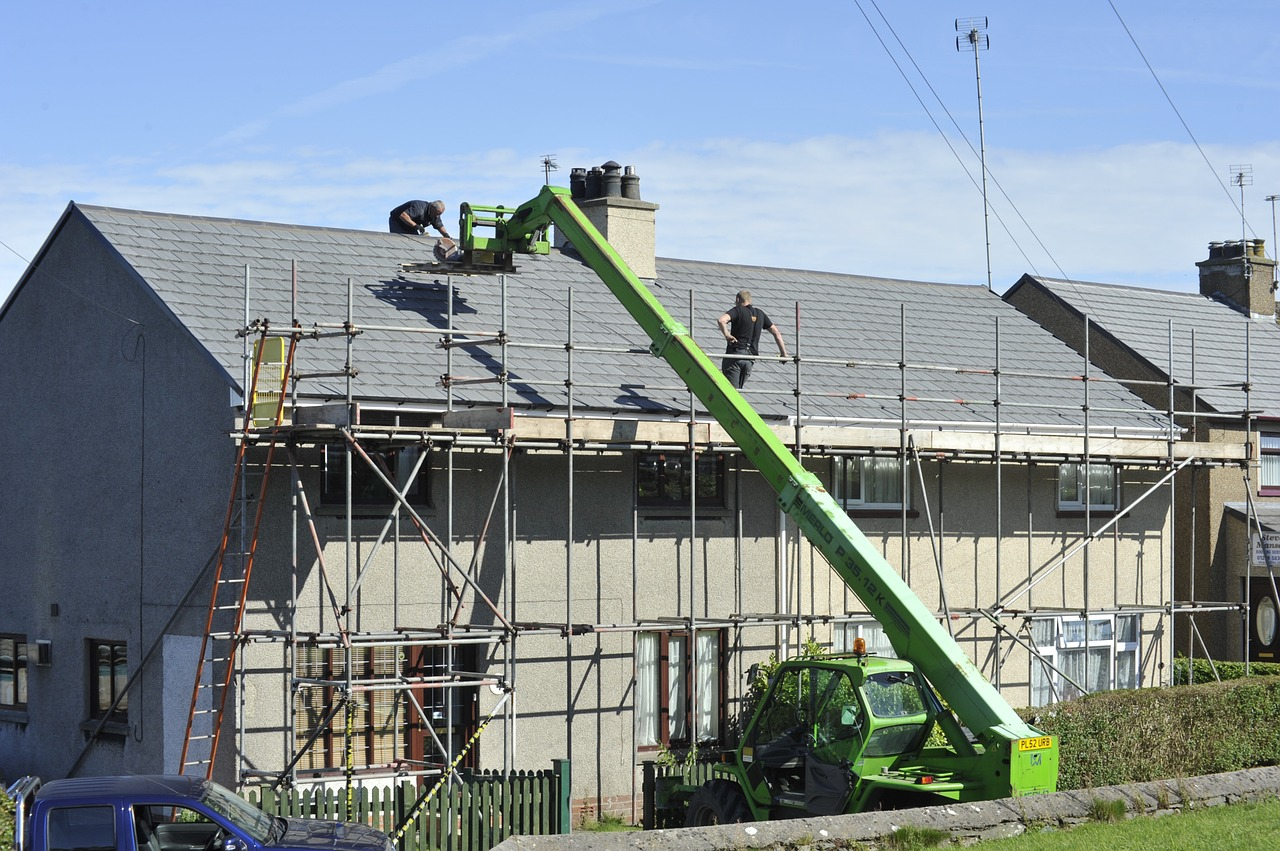 A major repair on a house roof that makes you wonder about how much you should save for home repairs.