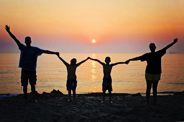 A family of four enjoying a sunset before family relocation from New Mexico to Miami