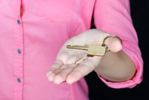 A person holding a house key