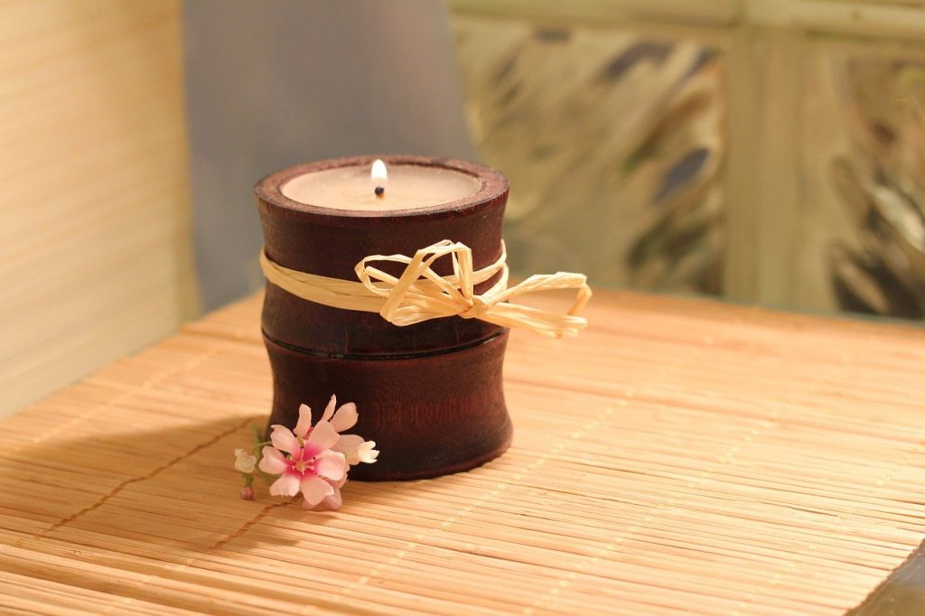 A lit scented candle.