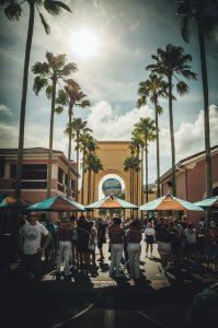 A crowd on Florida walkway.