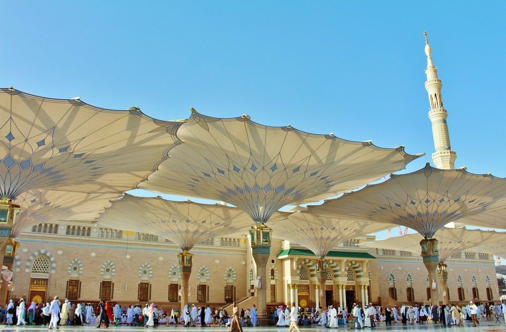 Islamic architecture of Medina with a lot of tourists passing