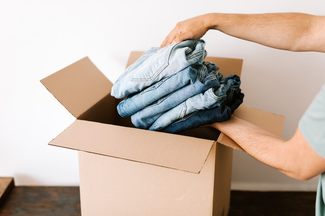 Packing clothes in a cardboard box