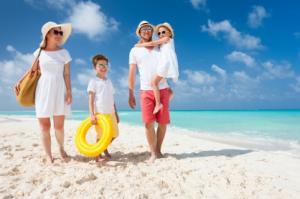 A family on a beach.
