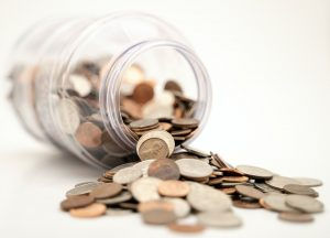 Coins in a jar symbolizing the money you need when moving from Texas to Florida after retirement.