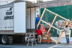 an image of movers loading a truck