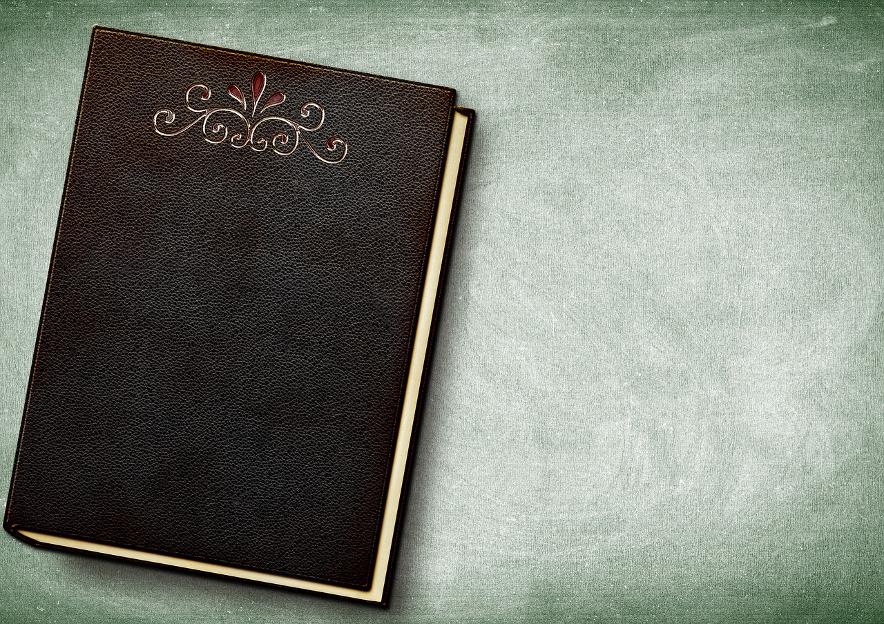 A notebook to write down a plan for buying a house and moving to Miami