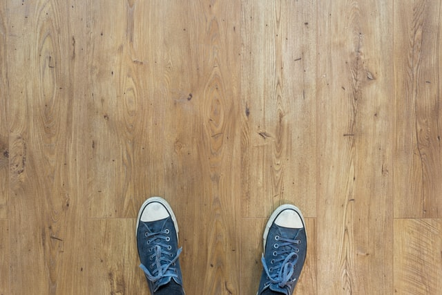 feet and a wooden floor,