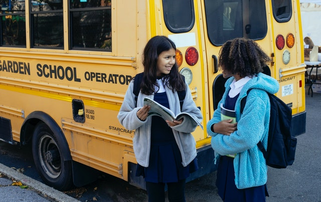 School kids in front of a bus