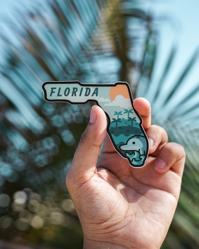 a person holding a sign that says Florida, read about Tips for pricing your house for sale